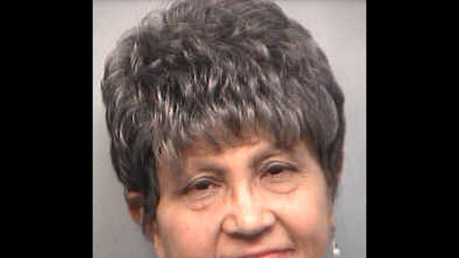 This Tuesday, April 2, 2013 booking photo provided by the Fulton County Sheriff shows former Atlanta Public Schools Superintendent Dr. Beverly Hall. Hall is among the thirty-five educators within the Atlanta school system named in a 65-count indictment last week that alleges a broad conspiracy to cheat, conceal cheating or retaliate against whistleblowers in an effort to bolster student test scores and, as a result, receive bonuses for improved student performance. Prosecutors set a Tuesday deadline for all defendants to surrender to authorities. (AP Photo/Fulton County Sheriff)