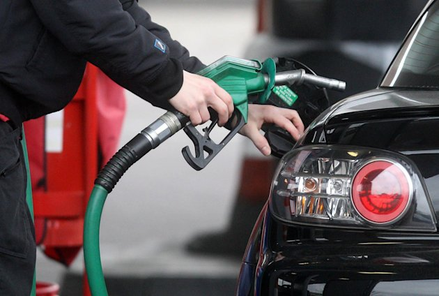 File photo dated 18/03/13 of a generic photo of a person using petrol pump as price rises have led to the pawning of possessions by some desperate drivers anxious to continue motoring, according to an AA/Populus survey.