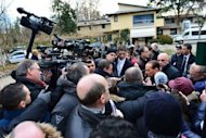 Italian former prime minister Silvio Berlusconi speaks to the press as he arrives at the AC Milan training grounds in Milanello. Berlusconi ended weeks of speculation by announcing he would run again for the job of prime minister, the post he was forced out of last year.
