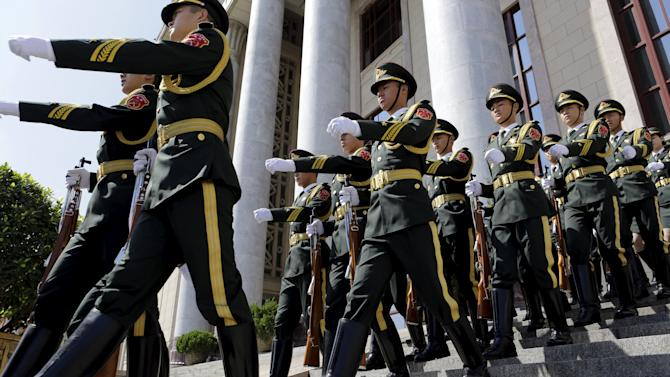Soldiers from the honor guards leave the Great Hall of the People after a medal ceremony in Beijing