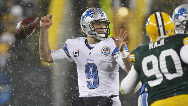 Detroit Lions quarterback Matthew Stafford fumbles the ball during the first half of an NFL football game against the Green Bay Packers Sunday, Dec. 9, 2012, in Green Bay, Wis. Green Bay Packers' Mike Daniels recovered the fumble and ran it back 43 yards for a touchdown. (AP Photo/Mike Roemer)