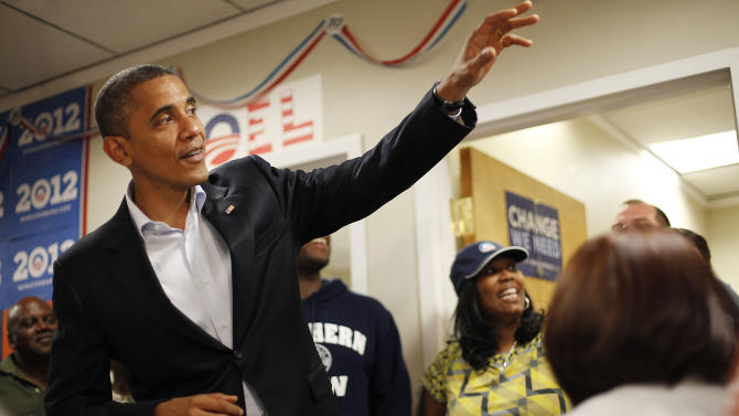 President Barack Obama waves to volunteers during an unscheduled visit to a local campaign field office, Sunday, Oct. 28, 2012 in Orlando Fla. (AP Photo/Pablo Martinez Monsivais)