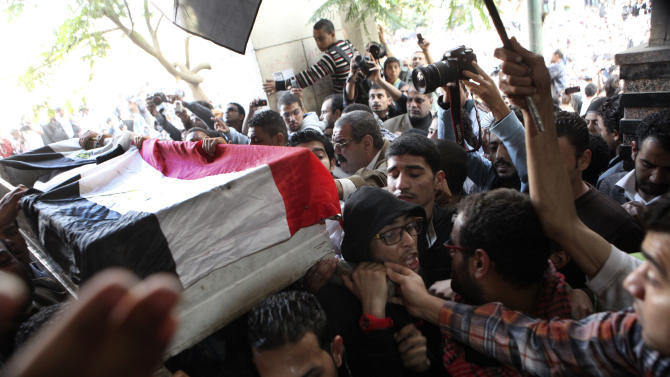 Egyptians carry the body of Gaber Salah, who was who was killed in clashes with security forces, inside a mosque for funeral prayers in Cairo, Egypt, Monday, Nov. 26, 2012. Thousands marched through Tahrir square, the birthplace of last year's uprising that toppled authoritarian leader Hosni Mubarak, for the funeral procession of Salah. (AP Photo/Thomas Hartwell)