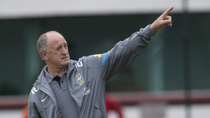 "FILE - In this May 31, 2013 file photo, Brazil's soccer team coach Luiz Felipe Scolari gives instructions to his players during a Brazilian national soccer team training session in Rio de Janeiro, Brazil. Scolari says, ""We all want justice in our country. Those in the government also want this. We can't only crucify. We all want it and we will work together for that. But it doesn't happen in a day. We have to work together to tackle some points so that hopefully in one, two, five or 10 years from now things can change."" (AP Photo/Silvia Izquierdo, File)"