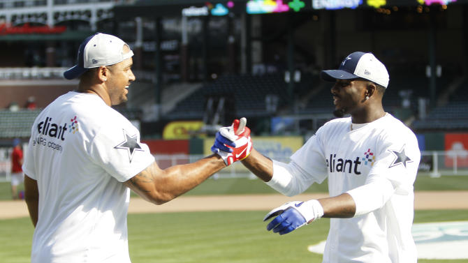 IMAGE DISTRIBUTED FOR RELIANT - Dallas Cowboys' Jason Hatcher, left, congratulates teammate Dez Bryant after competing in the Home Run Derby Competition hosted by Reliant raising $43,000 to benefit The Salvation Army on Wednesday, May 8, 2013 in Arlington, Texas. (Brandon Wade/AP Images for Reliant)