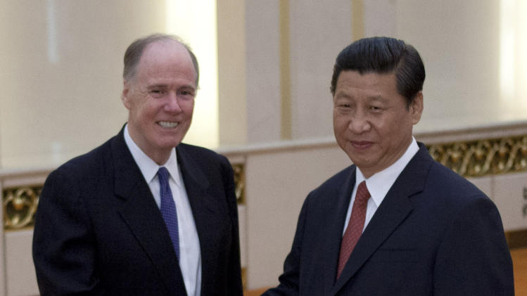 U.S. National Security Adviser Tom Donilon, left, poses with Chinese President Xi Jinping for photographers before their meeting at the Great Hall of the People in Beijing Monday, May 27, 2013. (AP Photo/Alexander F. Yuan, Pool)