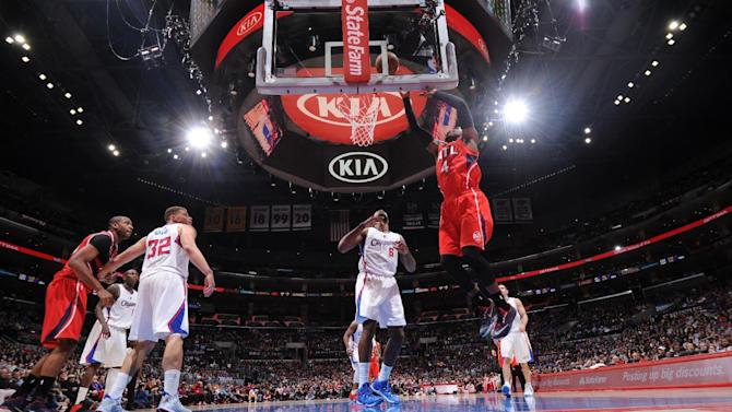 Hawks beat Clippers 107-98 for 7th straight road victory