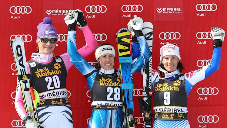 Spain's Carolina Ruiz Castillo, center, winner of an alpine ski, women's World Cup downhill race, celebrates on the podium with second-placed Germany's Maria Hoefl-Riesch, left, and third-placed France's Marie Marchand-Arvier, in Meribel, France, Saturday, Feb. 23, 2013. (AP Photo/Enrico Schiavi)