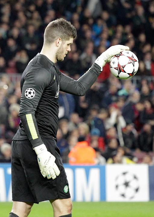 Celtic goalkeeper Fraser Forster reacts after Barcelona scored the 6th goal during a Group H Champions League soccer match between FC Barcelona and Celtic FC at the Camp Nou stadium in Barcelona, Spai