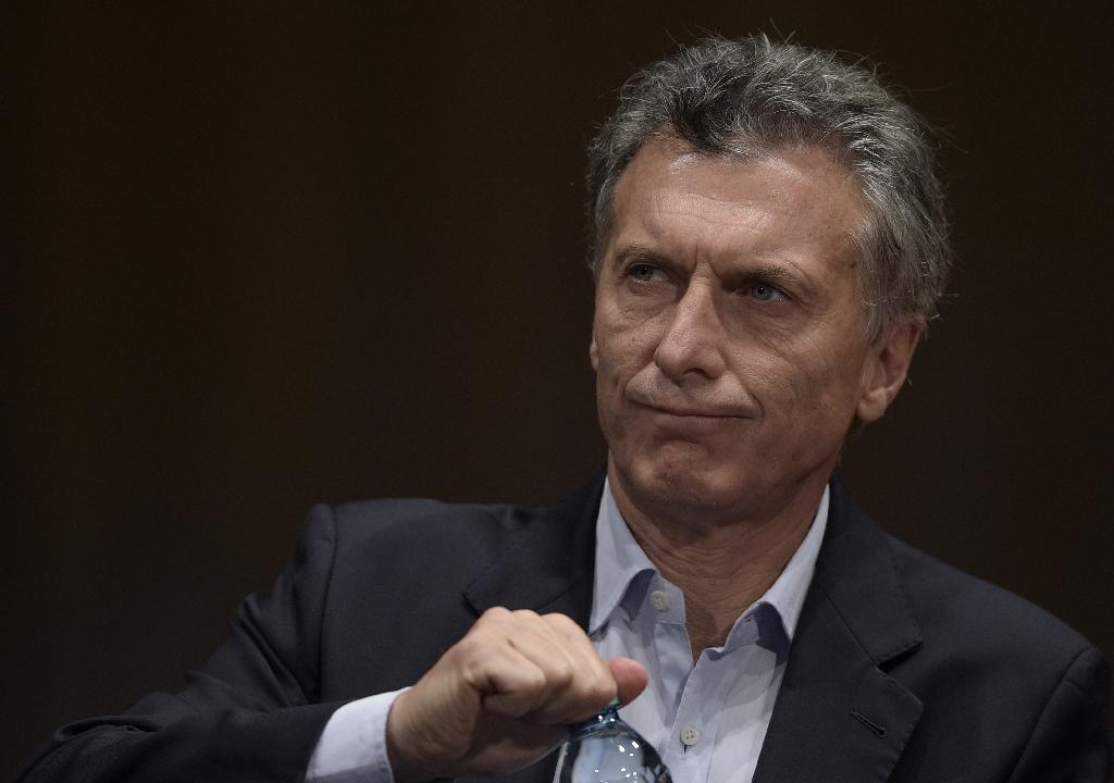 Obama vows better trade ties with new Argentine leader