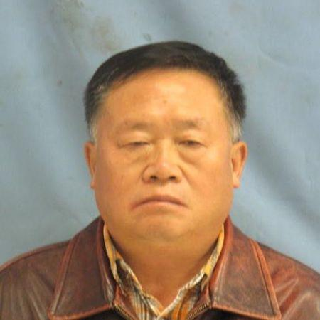 U.S. government worker pleads guilty in plot to steal rice for Chinese