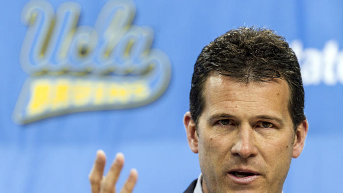 "CORRECTS MONTH - Steve Alford, UCLA's new men's basketball coach, gestures during a news conference at the Pauley Pavilion in Los Angeles, Tuesday, April 2, 2013. Alford was hired on Saturday, spurning New Mexico days after he agreed to a new 10-year deal with the Lobos for a chance to run what he called ""the premier basketball program in the country."" (AP Photo/Damian Dovarganes)"