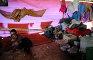 A Kachin mother and her child are seen in a refugee camp in May. hina has pushed thousands of refugees from Myanmar&#39;s Kachin minority back across the border into a province wracked by fighting between government troops and ethnic guerillas, the rebels said Friday