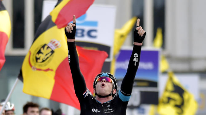 Sky team rider Ian Stannard of Britain crosses the finish line to win the Omloop Het Nieuwsblad cycling race in Ghent