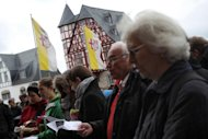 People demonstrate against their bishop in front of the bishop's house near the cathedral on October 13, 2013 in Limburg an der Lahn, western Germany