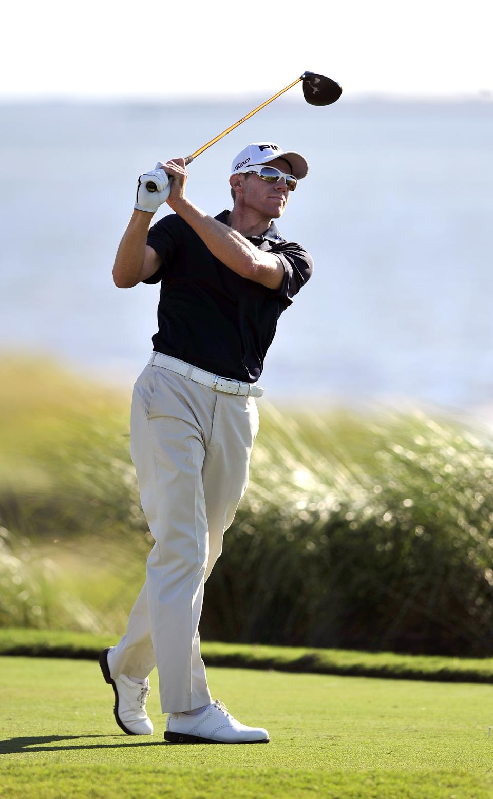 Nick O'Hern watches his drive down the 14th fairway during the second round of the McGladrey Classic golf tournament at the Sea Island Golf Club on St. Simons Island, Ga., Friday, Oct. 14, 2011. (AP Photo/Stephen Morton)