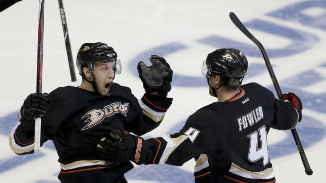 Anaheim Ducks center Nick Bonino, left, celebrates his game winning goal with Cam Fowler, against the Detroit Red Wings during overtime in Game 5 of their first-round NHL hockey Stanley Cup playoff series in Anaheim, Calif., Wednesday, May 8, 2013.  The Ducks won 3-2 in overtime.(AP Photo/Chris Carlson)
