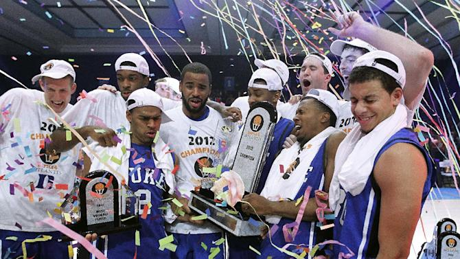 The Duke Blue Devils are blasted with confetti as they accept the trophy for winning the Battle 4 Atlantis college basketball tournament Saturday, Nov. 24, 2012, in Paradise Island,  Bahamas. Duke defeated Louisville 76-71 in the final. (AP Photo/John Bazemore)