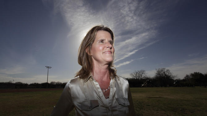 In this photo taken Wednesday, Feb. 29, 2012, Carol Bart poses for photos at a park in Richardson, Texas. In 1984, Bart was kidnapped and raped repeatedly in her car at knifepoint and she submitted to a rape kit at the time. It would be 24 years before the kit was tested, entered into the FBI's Combined DNA Index System and produced a hit on Joseph Houston Jr.  (AP Photo/LM Otero)