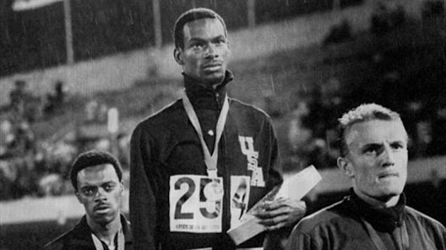 Bob Beamon stands with his gold medal