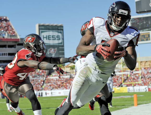 Atlanta Falcons wide receiver Julio Jones (11) is shoved out of bounds by Tampa Bay Buccaneers free safety Ahmad Black (43) during the second quarter of an NFL football game Sunday, Nov. 25, 2012, in