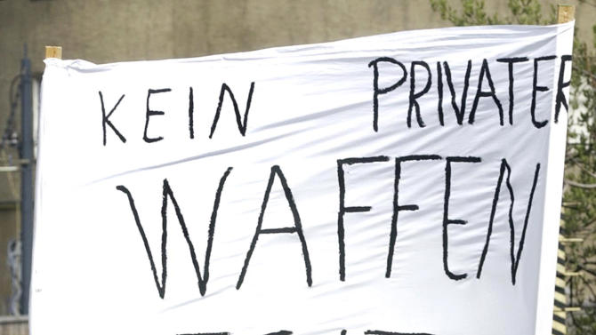 """FILE - In this May 1, 2002, demonstrators hold a banner reading """"No private possession of firearms"""" during a march five days after a 19-year-old former student shot 16 people before killing himself in a rampage shooting at a high school, in Erfurt, eastern Germany. Gun advocates, including the powerful lobby group the National Rifle Association, have blocked attempts to toughen American gun laws in the wake of previous mass shootings. Supporters of gun control often cite Australia's dramatic response to a 1996 shooting spree in the southern state of Tasmania that killed 35 people. Gun laws also were strengthened in Canada after the 1989 slaying of 14 female engineering students in Montreal by a woman-hating gunman, and in Germany after a 19-year-old expelled student killed 16 people, including 12 teachers, in Erfurt in 2002. (AP Photo/Jens Meyer, File)"""