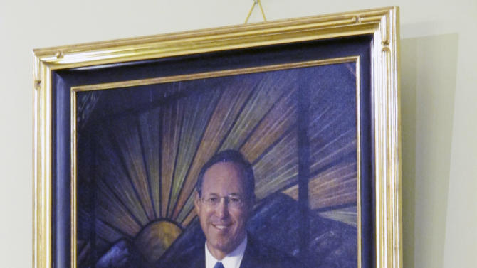 In this Jan. 3, 2013 photo, the portrait of former Gov. Bob Taft hangs in a hearing room at the Statehouse in Columbus, Ohio. Artists often put oil to canvas at this time of year to render official portraits of a governor or legislative leader who's coming or going from office. (AP Photo/Kantele Franko)