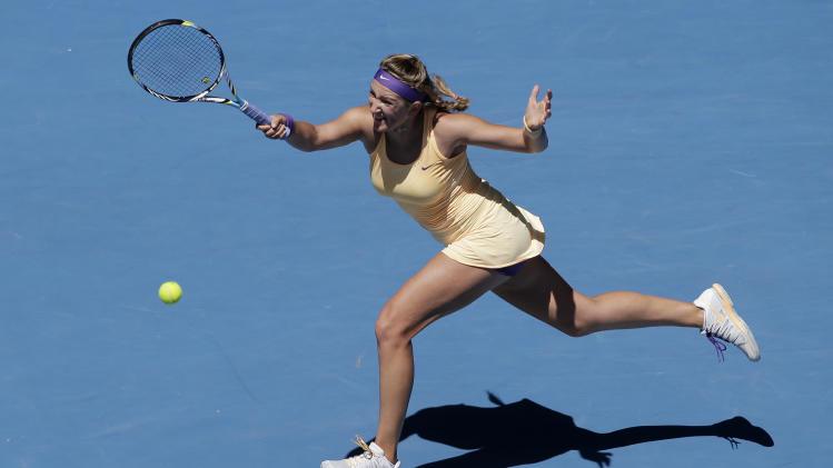 Victoria Azarenka of Belarus hits a forehand return to Russia's Svetlana Kuznetsova during their quarterfinal match at the Australian Open tennis championship in Melbourne, Australia, Wednesday, Jan. 23, 2013. (AP Photo/Rob Griffith)