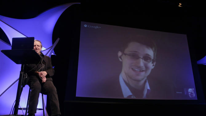 Former NSA contractor Edward Snowden participates in a conversation via video with John Perry Barlow, co-founder & vice chairman of the Electronic Frontier Foundation, at the 2014 Personal Democracy Forum, at New York University, Thursday, June 5, 2014 in New York. (AP Photo/Richard Drew)