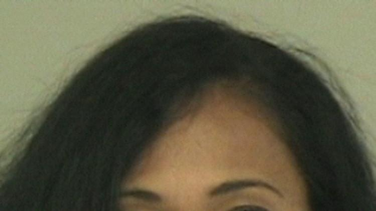 A photo provided by the Collin County Sheriff's Office shows Pilar Sanders.  An inmate listing on Collin County's website early Tuesday, April 24, 2012 shows that Pilar Sanders was arrested Monday and booked into the county jail on the family violence charge.  (AP Photo)