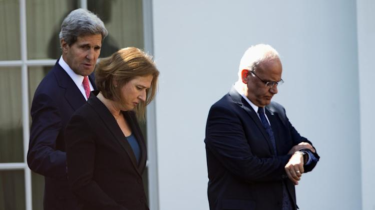 From left, Secretary of State John Kerry, Israeli Justice Minister Tzipi Livni and chief Palestinian negotiator Saeb Erakat leave the West Wing of the White House in Washington, Tuesday, July 30, 2013, after a meeting with President Obama. President Barack Obama on Tuesday delicately waded into the first round of Middle East peace talks in years, meeting privately at the White House with lead negotiators for the Israeli and Palestinian delegations. (AP Photo/Evan Vucci)