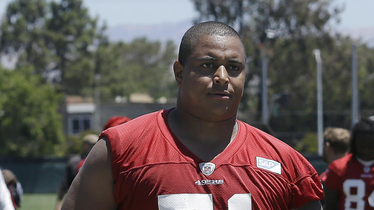 In this June 19, 2014, file photo, San Francisco 49ers offensive tackle Jonathan Martin walks off the field during NFL football minicamp in Santa Clara, Calif. Martin is concerning himself with all that he can control to earn a spot on the 53-man roster when final cuts are complete Aug. 30
