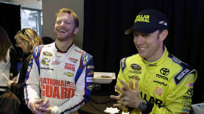 Dale Earnhardt Jr., left, and Matt Kenseth joke around during a break at NASCAR media day at Daytona International Speedway, Thursday, Feb. 14, 2013, in Daytona Beach, Fla. (AP Photo/John Raoux)