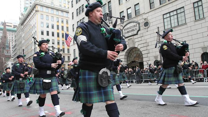 The Breezy Point Catholic Club Pipes and Drums, from the Queens borough of New York, make their way up New York's Fifth Avenue as they take part in the St. Patrick's Day Parade Saturday March 16, 2013. (AP Photo/Tina Fineberg)