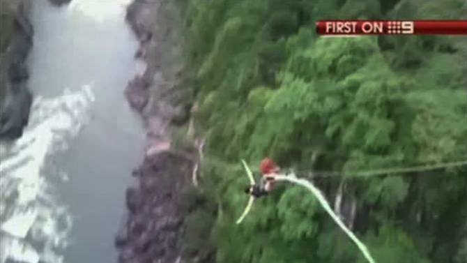 In this Saturday, Dec. 31, 2011 image made from video by Australia's Channel 9, Erin Langworthy, 22, of Perth, Australia, does bungee jumping to the Zambezi River in Victoria Falls, Zimbabwe, on the border with Zambia. The Australian tourist bungee jumping plunged 365 feet (111 meters) into the river when her cord snapped, but she managed to swim to safety with a broken collarbone and her legs tied together. (AP Photo/Channel 9 via APTN) MANDATORY CREDIT: CHANNEL 9, AUSTRALIA OUT