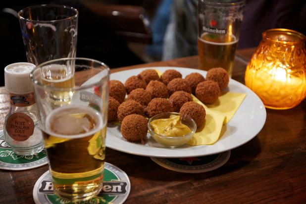 It figures that in Amsterdam there'd be a super-munchie such as bitterballen. Ground pork is cooked and mixed with cream sauce before it gets seasoned, shaped, breaded and then deep fried to a c