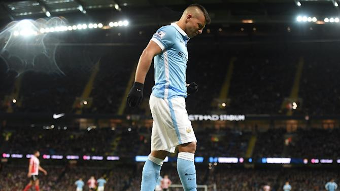 Manchester City's striker Sergio Aguero leaves the pitch after being injured during the English Premier League football match between Manchester City and Southampton at The Etihad stadium in Manchester, England on November 28, 2015