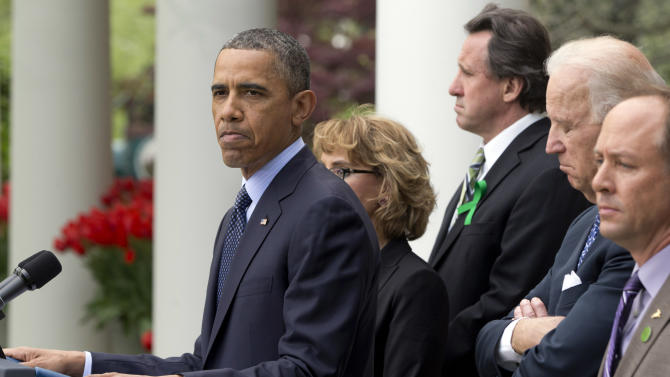 President Barack Obama frowns as he speaks during a news conference in the Rose Garden of the White House, in Washington, on Wednesday, April 17, 2013, about a bill to expand background checks on guns that was defeated in the Senate. He is joined by former Rep. Gabby Giffords, second from left, Vice President Joe Biden, and Newtown family members from left, Neil Heslin, father of Jesse Lewis; and Mark Barden. (AP Photo/Jacquelyn Martin)