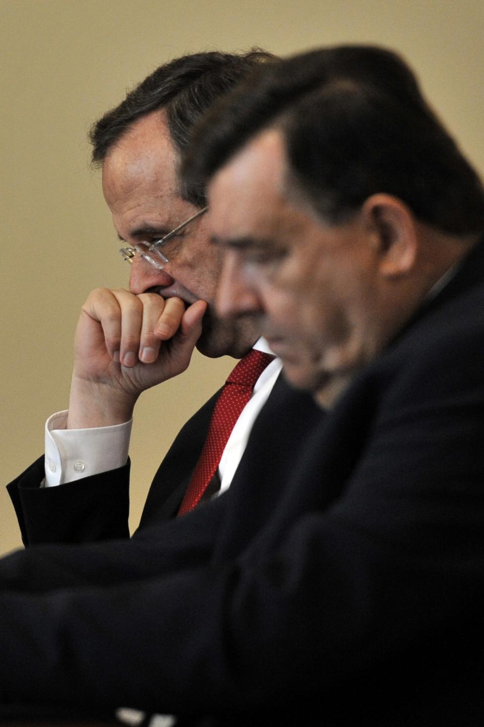 Greece's conservative leader Antonis Samaras, left and right-wing LAOS party leader Giorgos Karatzaferis attend a meeting in Athens on Friday May 27, 2011.Greek political leaders held crisis meeting to find consensus on austerity measures. (AP Photo/Aris Messinis,pool)