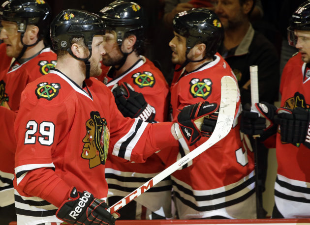 Chicago Blackhawks' Bryan Bickell (29) celebrates with teammates after scoring a goal during the first period of Game 5 of the NHL hockey Stanley Cup playoffs Western Conference semifinals against the