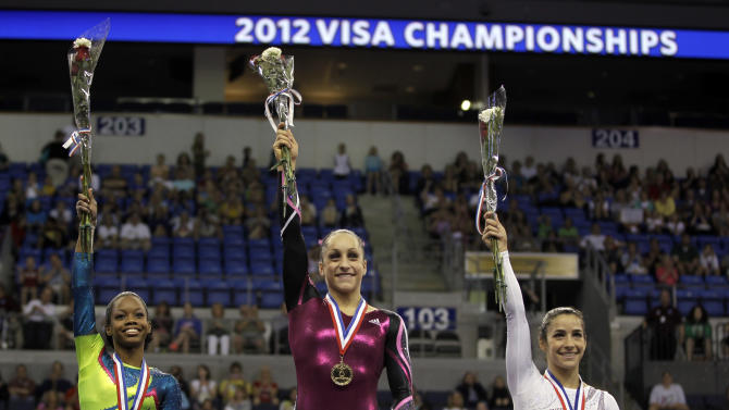 First-place winner Jordyn Wieber, center, stands on the podium with second-placed Gabby Douglas, left, and third-placed Alexandra Raisman at the women's senior division at the U.S. gymnastics championships on Sunday, June 10, 2012, in St. Louis. (AP Photo/Jeff Roberson)