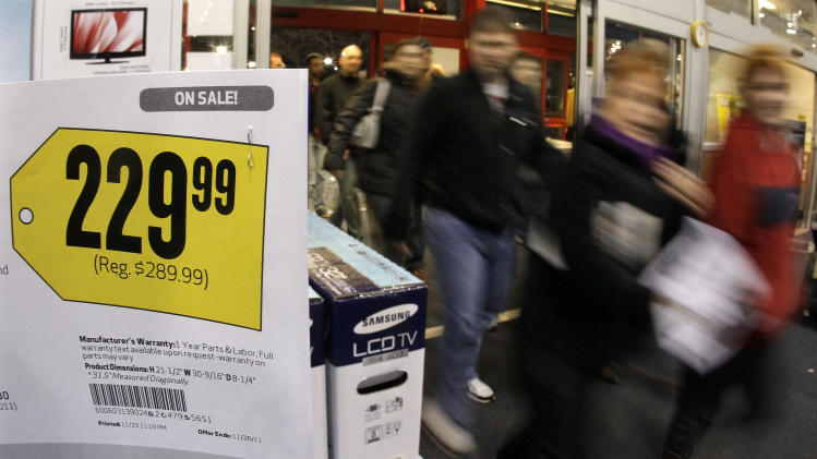 Shoppers enter a Best Buy store after a midnight opening on Friday, Nov. 25, 2011, in Brentwood, Tenn. Black Friday began in earnest as stores opened their doors at midnight. (AP Photo/Mark Humphrey)