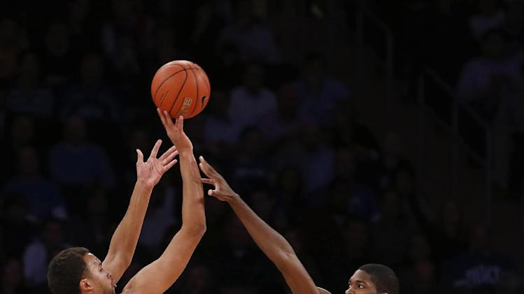 UCLA's Kyle Anderson (5) shoots against Duke's Amile Jefferson (21) during the first half of an NCAA college basketball game, Thursday, Dec. 19, 2013, in New York. (AP Photo/Jason DeCrow)