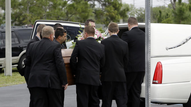 Pall bearers place the casket of country music star Mindy McCready into a hearse after a funeral ceremony at the Crossroads Baptist Church in Fort Myers, Fla., Tuesday, Feb. 26, 2013.  McCready committed suicide on Feb. 17 at her home in Arkansas, days after leaving a court-ordered substance abuse program. (AP Photo/Alan Diaz)