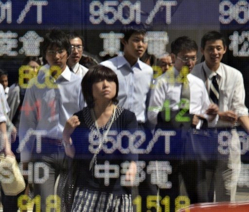 <p>Japan on Monday said its economy grew by 0.2 percent in the April to June quarter from the previous three months, revising downwards a preliminary figure of 0.3 percent growth.</p>