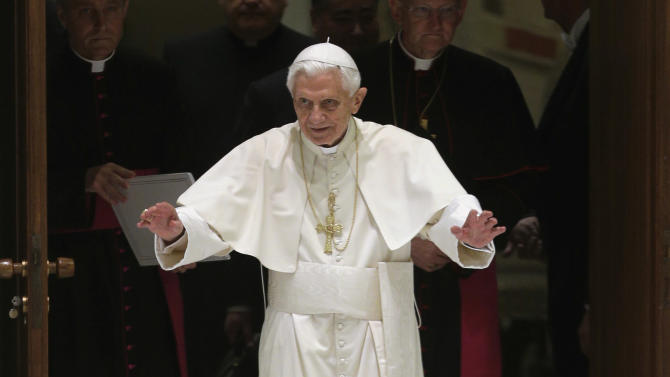 """Pope Benedict XVI waves upon his arrival for a meeting with the """"Santa Cecilia"""" association, at the Vatican, Saturday, Nov. 10, 2012. Latin is being resurrected at the Vatican. Pope Benedict XVI issued a decree Saturday creating a new pontifical academy for Latin studies to try to boost interest in the official language of the Roman Catholic Church that is nevertheless out of widespread use elsewhere. Benedict acknowledged Latin's fall from grace, saying future priests nowadays often learn only a """"superficial"""" appreciation of Latin in seminaries. The new academy, which is part of the Vatican's culture office, will promote Latin through conferences, publications and instruction in Catholic schools, universities and seminaries. (AP Photo/Alessandra Tarantino)"""