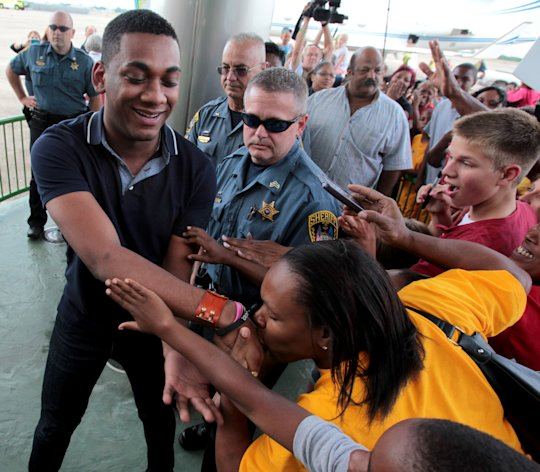 """American Idol"" finalist Joshua Ledet of Westlake, La., is greeted by fans after his arrival from Los Angeles at Chennault International Airport in Lake Charles on Friday, May 11, 2012. Ledet, the 20-year-old top-three finalist on Fox's TV singing competition will be honored with a parade in his home town on Saturday, May 12, 2012, and a pep rally in Burton Coliseum in Lake Charles that evening. (AP Photo/K Wink, LAKE CHARLES AMERICAN PRESS)"