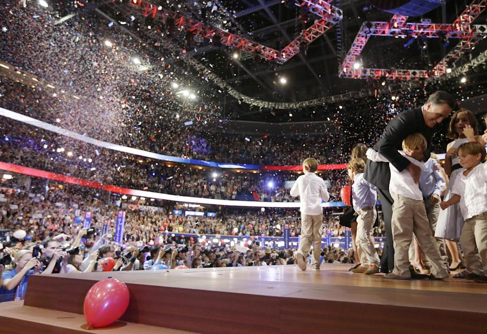 Republican presidential nominee Mitt Romney hugs his grandchildren after his speech at the Republican National Convention in Tampa, Fla., on Thursday, Aug. 30, 2012.  (AP Photo/David Goldman)