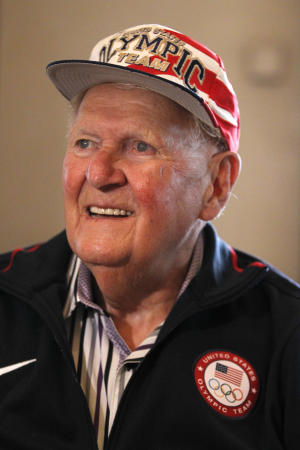 US 1948 gold medalist Ray Lumpp poses in a US team cap after he talked to Associated Press in London, Friday, Aug. 10, 2012. Ray Lumpp is in London to be a mascot of sorts for the US basketball team playing in the London 2012 Olympic Games. (AP Photo/Sang Tan)