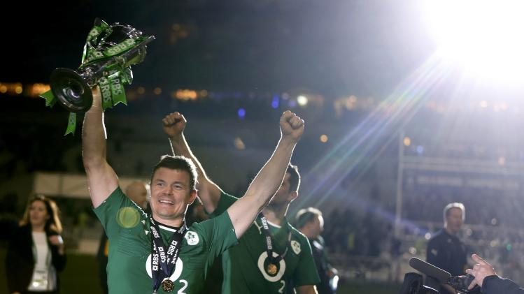 Ireland's O'Driscoll holds the cup after his team defeated France in their Six Nations rugby union match at the Stade de France in Saint-Denis, near Paris